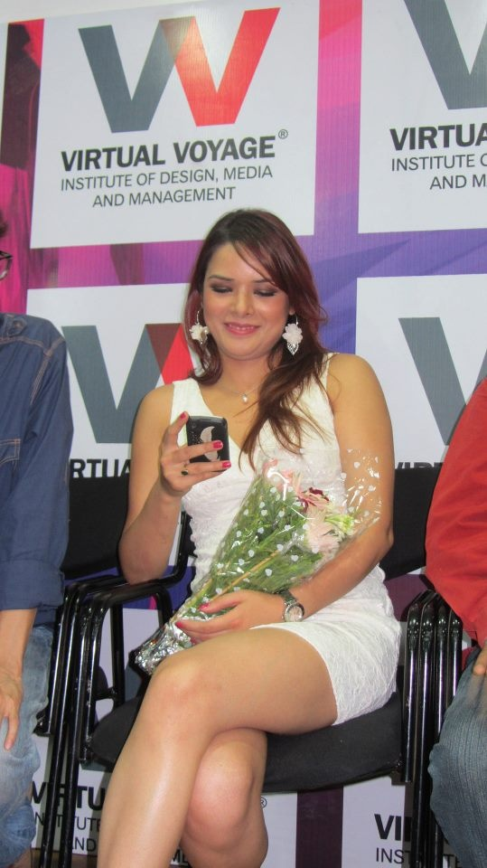 Udita Goswami busy with mobile