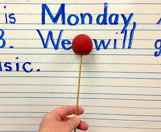 KFUNdamentals: My Spaghetti & Meatball Pointer.  Kids leave a meatball sized space between words, and a spaghetti sized space between letters.  (Made with a bamboo skewer and a wooden bead.)