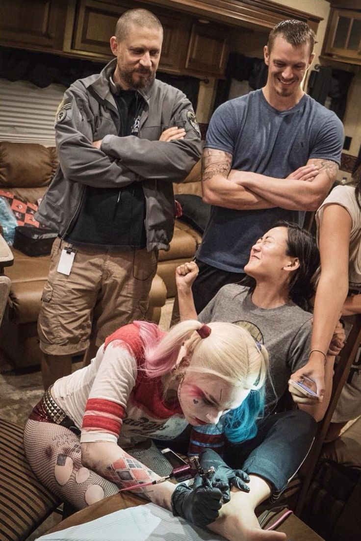 "Margot Robbie tattoed her coworkers with ""SKWAD"" while fully dressed as Harley Quinn"