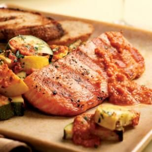 Grilled Salmon & Zucchini with Red Pepper Sauce-- Simply grilled salmon and vegetables with a zesty sauce based on the classic Spanish romesco. Made with roasted red peppers, tomatoes and almonds, this sauce is a great match for any seafood, poultry or vegetables. #salmon #recipe