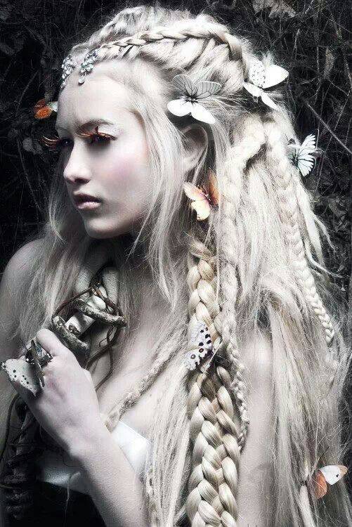 When I imagine Titania, I see a woman with long, braided hair. This picture fits with my description because it is more of a natural look especially with the butterflies placed in it. I also visualize Titania with more of a pale complexion. It almost feels more like shes one with nature. With this look it also gives her the impression that she does not need a man and she is more of a strong, self-dependent person.