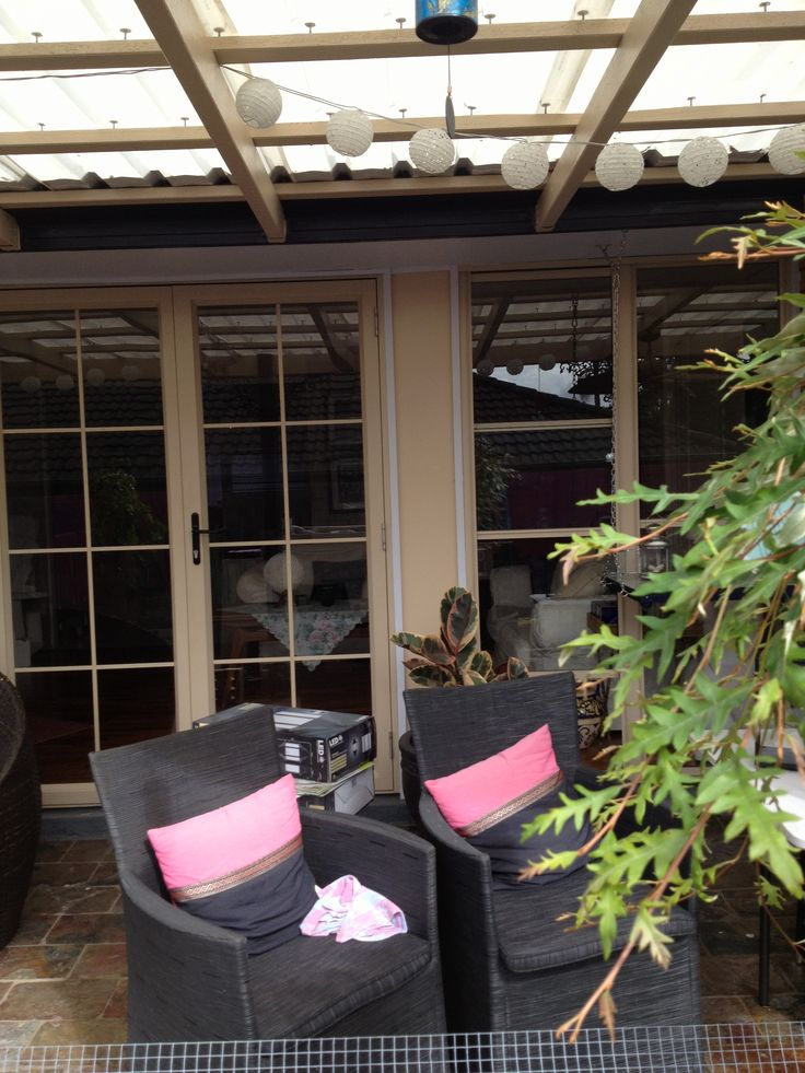 built sunroom and replaced pergola roof - solar reflective sheeting lights and fans yet to be installed