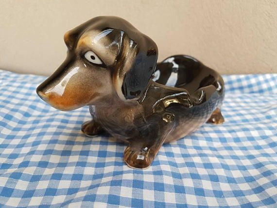 Check out this item in my Etsy shop https://www.etsy.com/au/listing/540573305/vintage-dachshund-ashtray-very-cute