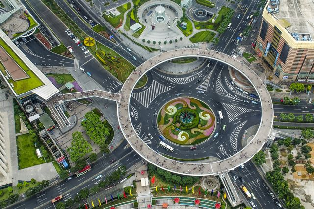 The new Lujiazui circular pedestrian bridge in Shanghai is a 5.5-meter-high walkway and can fit 15 people walking side by side