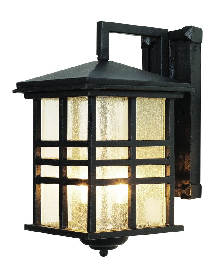 Rustic mission style outdoor coach light perfect for rustic cabin décor. Clear seeded glass in three bar frame. Finish: Black Height: 13'' Width: 8.5'' Depth: 10.5'' Bulb: 2-Candelabra - E12 Wattage: