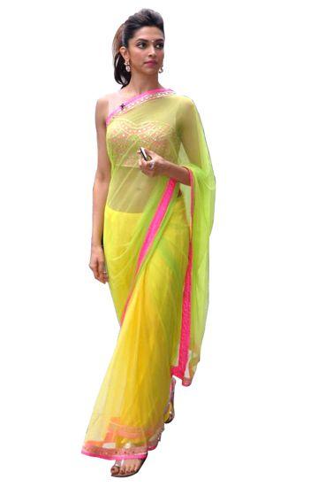 Deepika Padukone wears a neon Arpita Mehta sari.