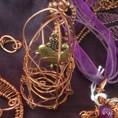 doinWire handcrafted copper wire Pendant. handcrafted copper bird cage with bird charm. (pic 1of2) DOW619