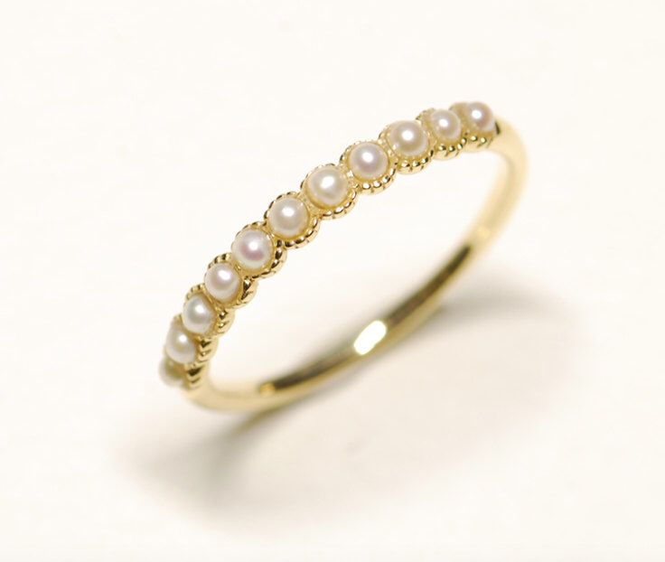 On Sale- Half Eternity Wedding Band in 10k Gold with pearls ,Pearl Wedding Ring, Anniversary Ring, Stackable Pearl band by KabellaCustomJewelry on Etsy https://www.etsy.com/listing/490715993/on-sale-half-eternity-wedding-band-in