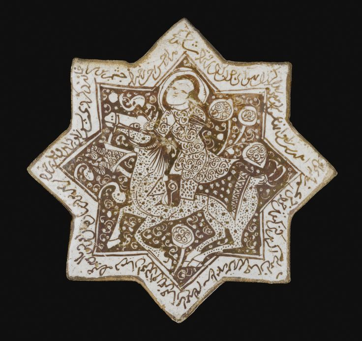 A KASHAN LUSTRE STAR TILE DEPICTING A FIGURE ON HORSEBACK AND INSCRIPTIONS, PERSIA, MID 13TH CENTURY