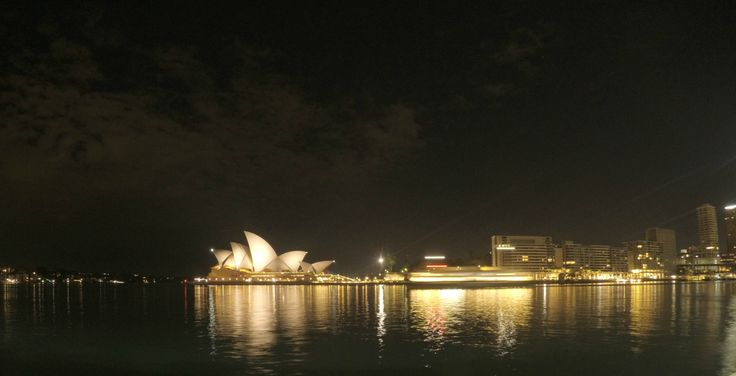 Sydney Opera House and Circular Quay at night.
