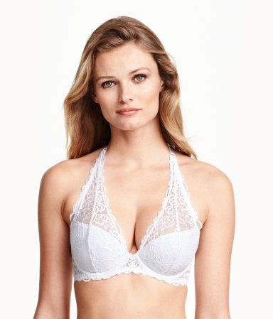 Halterneck push-up bra in lace. Adjustable strap at neck, padded underwire cups with removable inserts to maximize bust and cleavage, and fastener at back.