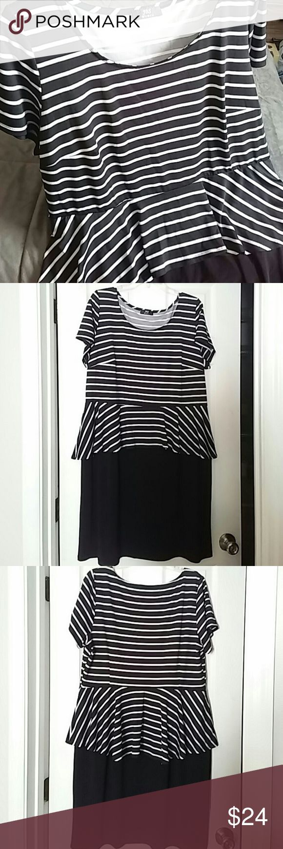Peplum dress in jersey matte Cute black and white peplum dress.  Length is to the knee.  Wrinkle free and machine wash.  Never worn or washed. Dresses Maxi