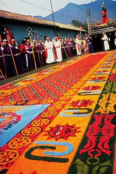 During Semana Santa in Guatemala they make these alfombras out of sawdust, but the next day the parade walks right over them.