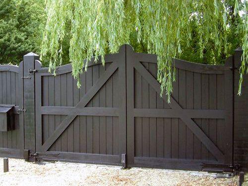 Black wooden driveway gate. #drivewaydoor, #drivewaygate, #garagedoor4less                                                                                                                                                     More