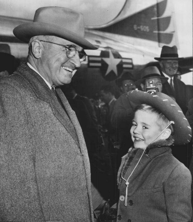 1952 presidential elections -- President Truman greets a little boy with a different kind of hat.