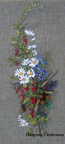 Ribbon embroidery. The white daisies really pop against the fabric and other flowers.