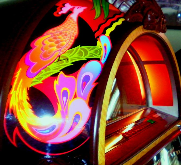 Pretty Colours. A close up of our Rock-Ola Peacock CD #Jukebox. Take a closer look: http://www.gamesroomcompany.com/Product_Catalogue/Jukeboxes/CD_Jukeboxes/Rock-Ola_Peacock_CD_Jukebox_11943 #Vintage
