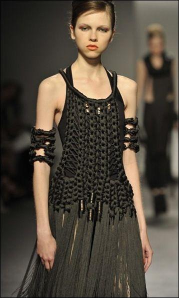 eleanor amoroso - shiny thick and black knitwear