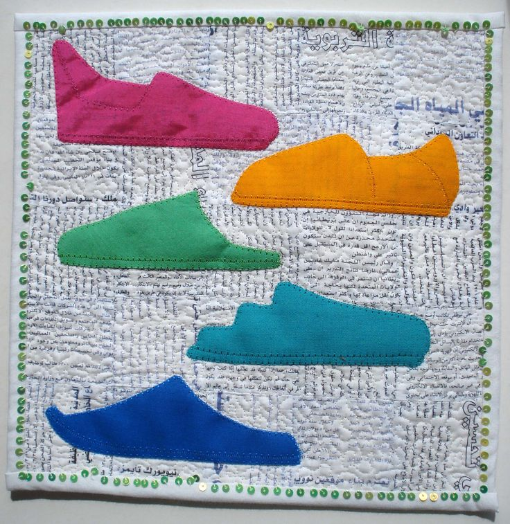 June: Moroccan slippers, some of the many designs. Background patchwork made from home printed fabric from an Arabic newspaper. Sequins stitched to the edge. Made by Greta Fitchett.