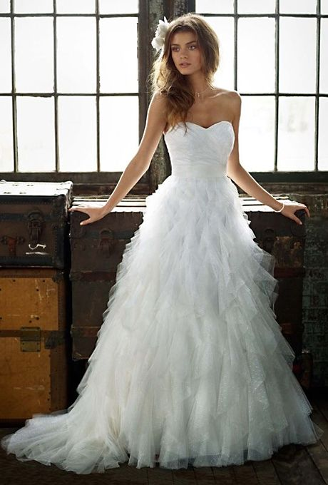 Brides.com: Affordable Wedding Dresses (Under $1,000!). Galina. Strapless tulle ruffle ball gown, style PK3357, $599, Galina, available at David's Bridal  See more David's Bridal wedding dresses