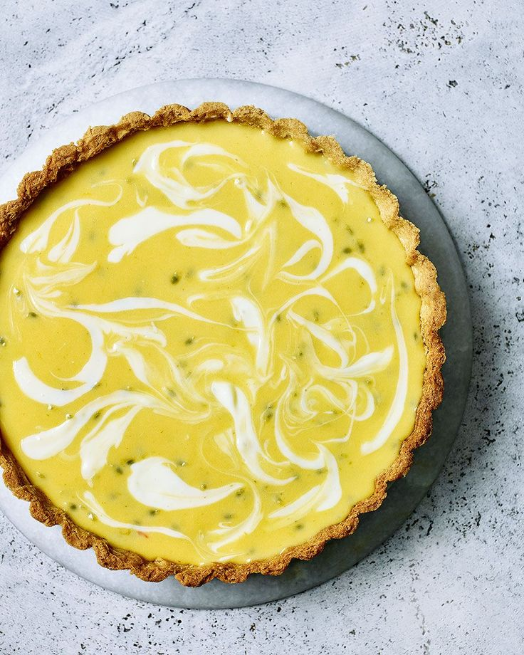 Is it a cheesecake? It is a tart? Even better, it's both. Try this zesty lemon, lime and passion fruit tart for a dinner party dessert that's guaranteed to impress.