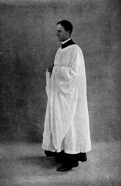 Priest in cassock and surplice. Robes and the Choir Habit, by Percy Dearmer (1933).