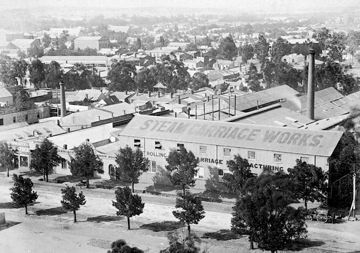 Steam carriage works of Bendigo Rolling Stock company, Bendigo, 1890. An elevated view of the steam carriages works of the Bendigo Rolling Stock company. The corrugated iron buildings include several long sheds and several chimneys. The company was established by Peter Ellis, and was renamed Bendigo Rolling Stock company around 1890. It undertook several major contracts in the 1880s and 1890s to build goods trucks and other rollingstick for Victorian Railways.