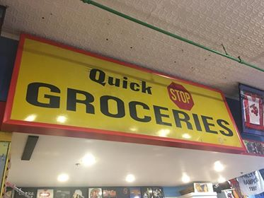 A Quick Stop Groceries sign in Jay and Silent Bob's Secret Stash comic book & novelty store in Red Bank, New Jersey. The Quick Stop convenience store in nearby Leonardo was the setting of Kevin Smith's breakthrough film Clerks and was featured in subsequent films, comic books, & TV series. Photo by my girlfriend Stephanie.