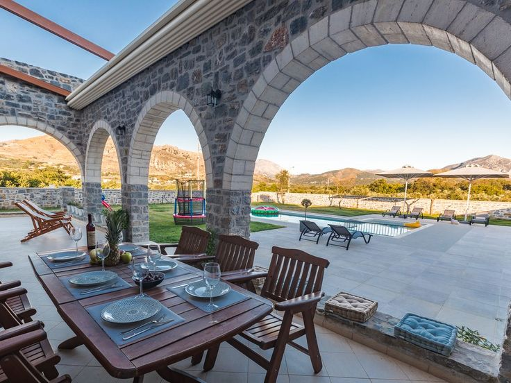 Foinikas villa rental - Dining area next to the pool, which can provide shade or open it!