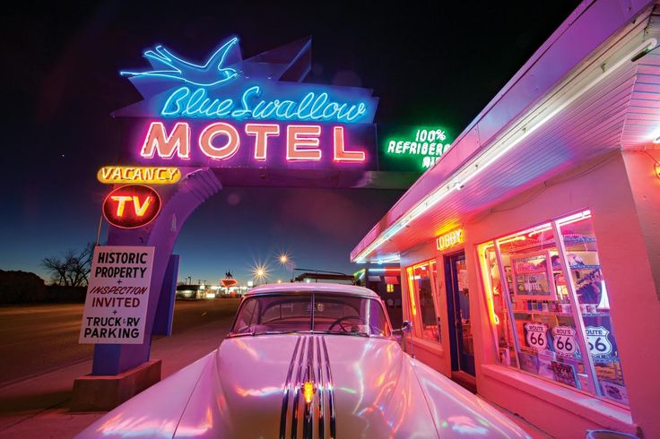Picture of a historic car parked at the Blue Swallow Motel in Tucumcari, New Mexico