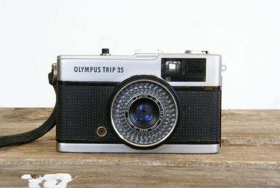Olympus Trip 35 Vintage Metal Camera by LarchTradingCompany, $48.00 Vintage Olympus Trip 35 metal camera. This camera was introduced by Olympus in 1967. All functions appear to be in excellent working order. Selenium light meter circles the lens. Dials allow you to adjust aperture, distance, and asa. Camera takes 35 mm film. Well known and sought after point and shoot camera. Camera has yet to be tested with film and is sold as is.