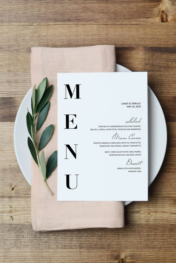 Gorgeous pink and black and white minimal menu, napkin, and greenery