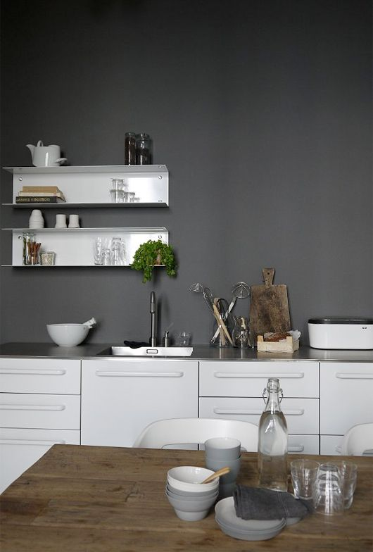 Floating thin metal shelf creates a space to the edge.  image from Trendenser.se