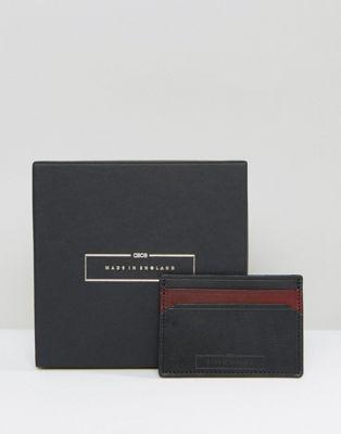 Tarjetero de cuero en color guinda y negro hecho en Inglaterra de ASOS