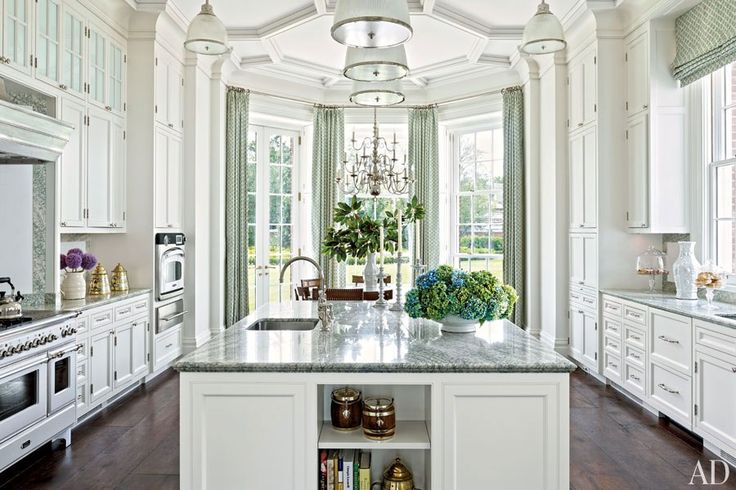 Allan Greenberg designed the classic white kitchen cabinetry in this Houston home.