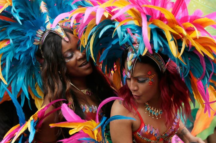 August 30 Crowds dance in the streets during the Notting Hill Carnival parade.