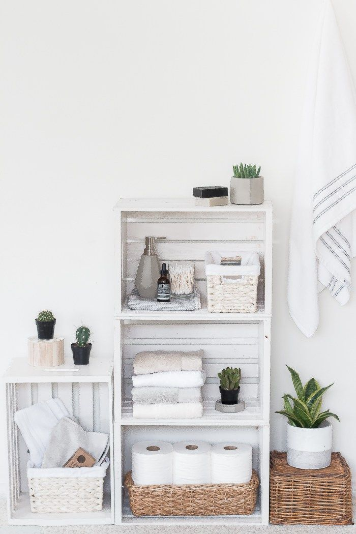 Refresh and organize your bathroom with this DIY crate shelves