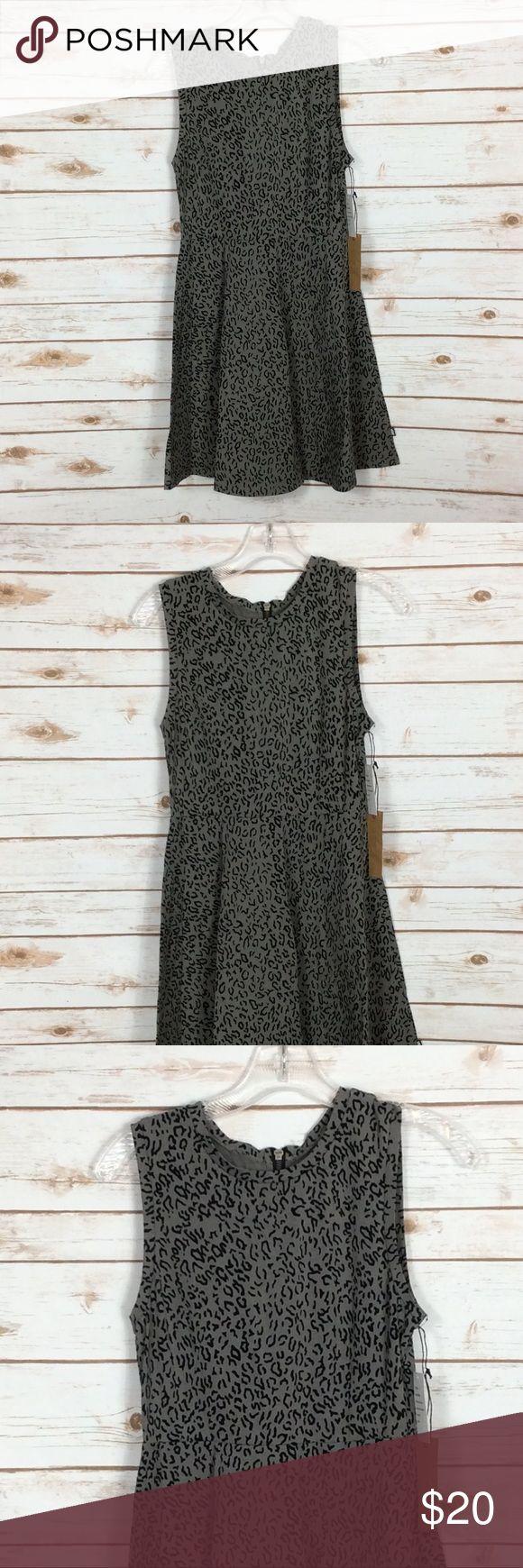 "Vans Dress Size medium. Cotton elastic blend. Skater fit. Has stretch. Black grey animal print. Zip back. Measurements approximately: Underarm to underarm 16"" Length 33"" Vans Dresses Mini"