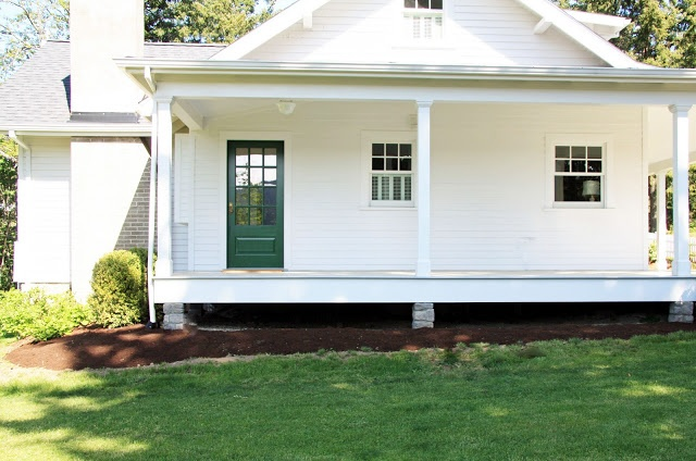 Side porch via A Country Farmhouse