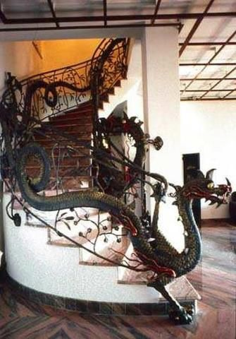 This dragon stair railing is the work of Giuseppe Celeprin, an Italian artist with a passion for metal works.