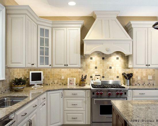St cecilia granite with white cabinets kitchen for Blue and cream kitchen ideas
