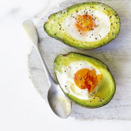 Baked eggs and avocado. Preheat the oven to 180C. Slightly enlarge the hole left by the stone by scooping out some of the avocado flesh with a spoon. Turn the avocado over and take a small slice off the bottom to stop it wobbling in the oven. Place each avocado half on a baking tray and then crack an egg into each hole. Season and bake in a preheated oven for 12–15 minutes or until the eggs are cooked. Remove from the oven, transfer to two plates and sprinkle over the lemon zest and a…