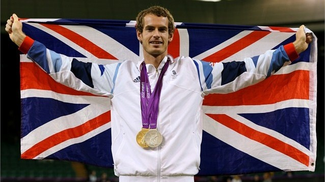Great Britain's Andy Murray poses with his gold and silver Tennis medals on Day 9 at Wimbledon. Murray won the men's Singles competition beating Roger Federer and picked up his silver in partnership with Laura Robson in the Mixed Doubles.