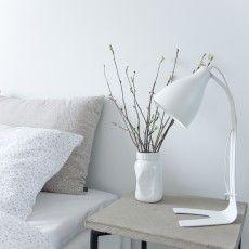 White timeless Scandinavian table lamp in metal by a bed // Linn - Sessak