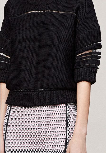 Black sweater with sheer striped sleeves; chic knitwear details // Pringle of…