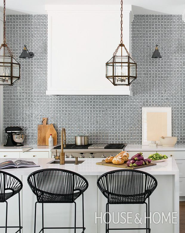 This modern, exotic kitchen by designer Samantha Farjo packs a graphic punch, with Acapulco-style bar stools and a patterned backsplash that mimics the look of on-trend cement tiles. | Photographer: Alex Lukey