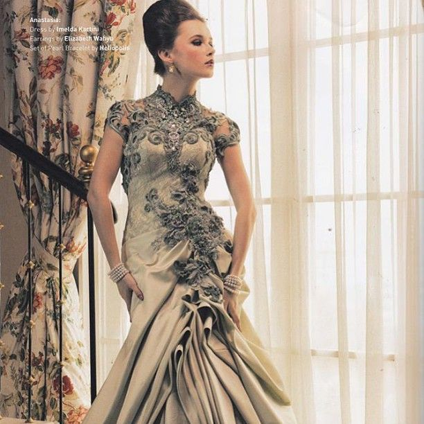 I'll never have a reason to wear such a beauty, but gorgeous. Dress By Imelda Kartini