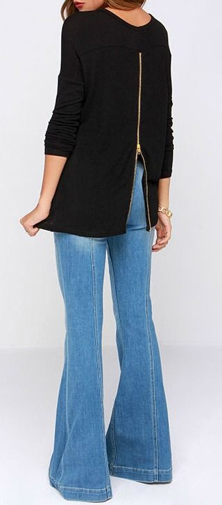 Did your heart just skip a beat? The Zip to My Lou Black Sweater Top has been known to have that effect! Soft black knit is just what you need, with long sleeves, a splendid scoop neck, and a high-low hem. An exposed zipper down the back adds a little edgy appeal in shiny gold. #lovelulus