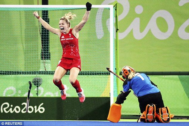 Team GB's  Holly Webb jumps and punches the air after her penalty clinches gold in the women's hockey at Rio 2016