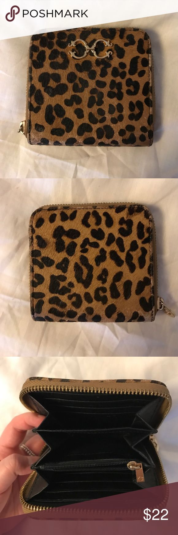 C Wonder Cheetah Zipper Wallet Rare cheetah print small zipper wallet with original tag and bag! The wallet was used only a handful of times with minor scuffing c wonder Bags Wallets